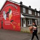 A woman passes a mural depicting Argentinian revolutionary Ernesto Che Guevara painted on a building in the Republican area of Bogside, a neighborhood outside the city walls, in Londonderry in Northern Ireland, UK, Feb. 28, 2019. EPA-EFE/NEIL HALL