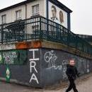 Children play next to pro-IRA graffiti on a building in the Republican area of Bogside, a neighborhood outside the city walls, in Londonderry in Northern Ireland, UK, Feb. 28, 2019. EPA-EFE/NEIL HALL