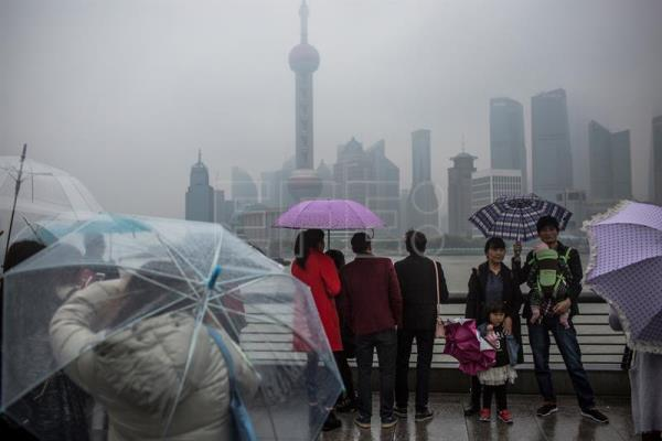 Thousands evacuated, flights canceled as Shanghai braces for typhoon