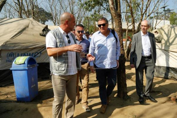 UNHCR official (L) explains their activities to Pier Antonio Panzeri, chair of the European Parliament's Subcommittee on Human Rights (C) and member of parliament Richard Corbet (R) at the UNHCR transit point at Ghumdum in UKhiya, Cox's Bazar, Bangladesh, 12 February 2018. EPA/ABIR ABDULLAH