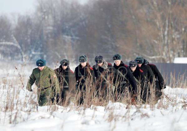 Russian soldiers walk to secure an area, where rescuers search for human remains and collect plane debris at the site of the crashed Russian Saratov Airlines Antonov AN-148 passenger plane near the Stepanovskoy village near Argunovo, Ramensky district, Moscow region, Russia, Feb. 12, 2018. EPA-EFE/YURI KOCHETKOV