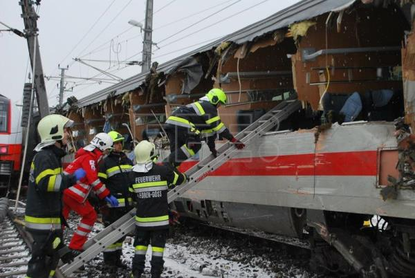 Rescue personnel enter a damaged wagon after two passenger trains collided in Niklasdorf, Austria, Feb. 12, 2018. EPA/BFV LEOBEN / SCHOENAUER HANDOUT