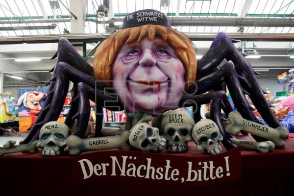 A float depicting German Chancellor Angela Merkel as a spider prior to the annual Rose Monday parade in Dusseldorf, Germany, Feb. 12, 2018. EPA-EFE/FRIEDEMANN VOGEL
