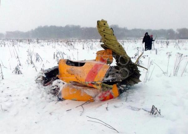 Debris of the crashed Russian Saratov Airlines Antonov AN-148 passenger plane lies in the snow near the Stepanovskoy village near Argunovo, Ramensky district, Moscow region, Russia, Feb. 11, 2018. EPA-EFE/ALEXANDER OLEINIKOV