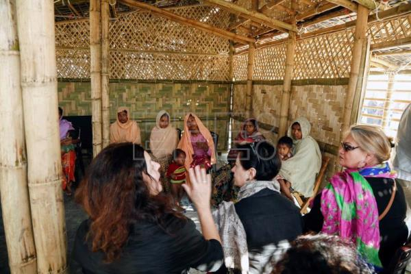 Members of the European Parliament's Committee talks with the newly arrived Rohingya women at the UNHCR trasit point at Ghumdum in UKhiya, Cox's Bazar, Bangladesh, 12 February 2018. EPA/ABIR ABDULLAH