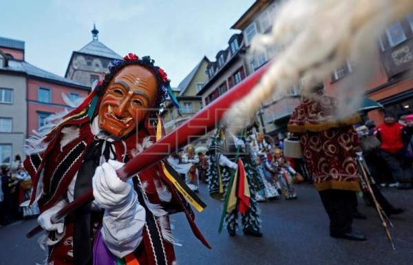 A so-called 'Federahannes', a jester figure from Rottweil, poses during the 'Narrensprung' (lit. jester jump) parade in Rottweil, Germany, Feb. 12, 2018. EPA-EFE/RONALD WITTEK