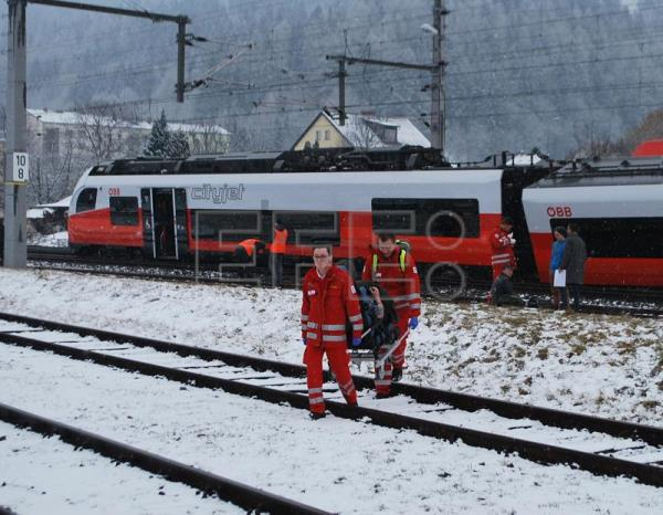 Rescue personnel carry injured passengers away after two trains collided in Niklasdorf, Austria, Feb. 12, 2018. EPA/BFV LEOBEN / SCHOENAUER HANDOUT