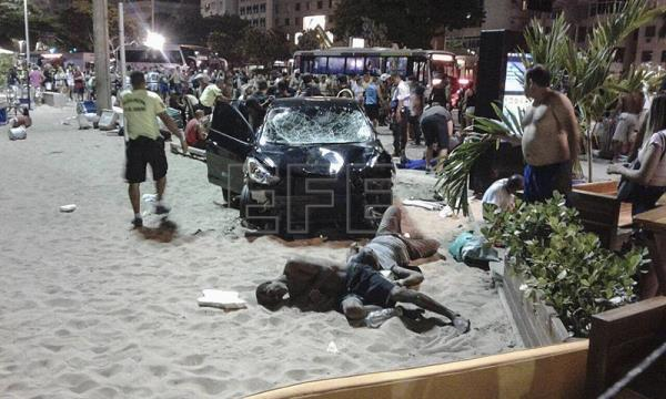 Injured people lie on the ground on Jan. 18, 2018, at the place where a driver plowed into a crowd of pedestrians near the famed Copacabana beach in Rio de Janeiro (Brazil) after suffering an epileptic attack. A baby girl was killed and 16 others were injured in the accident. EPA-EFE/Andrea Usero
