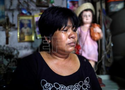 Grieving mother looks to religion after turning back on Duterte drug war