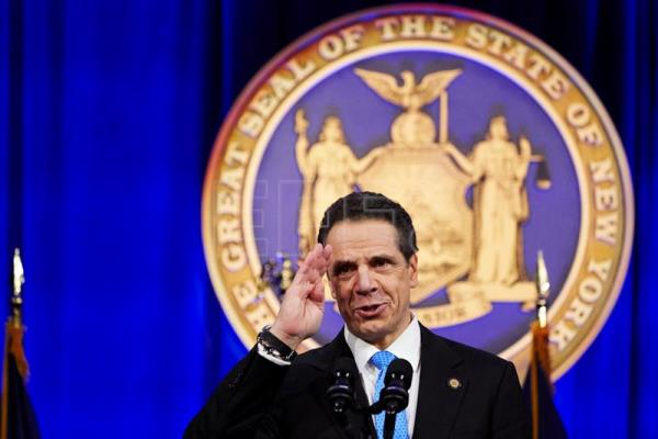 The governor of New York state, Andrew Cuomo, gives a speech after taking the oath of office during an inauguration ceremony on Ellis Island in New York, New York, USA, Jan. 1, 2019. Cuomo won a third term in a re-election in 2018. EPA-EFE/JAMES KEVIOM