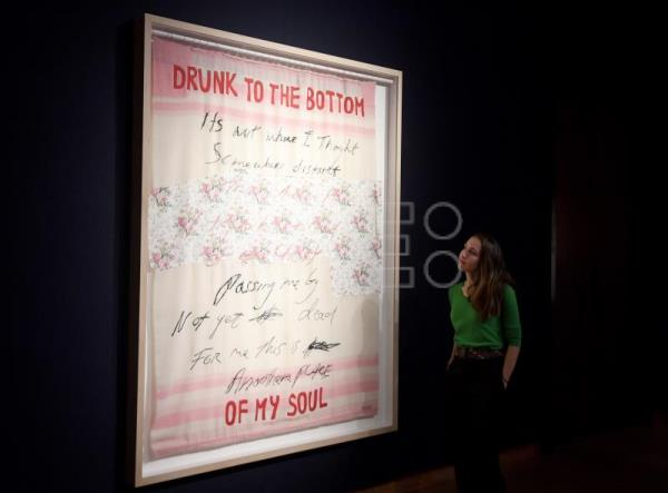 A woman looks at an artwork entitled 'Drunk to the Bottom of My Soul' by British artist Tracey Emin, formerly owned by the late British singer George Michael, during a press preview at Christie's auction house in London, Britain, March 8, 2019. EPA-EFE FILE/FACUNDO ARRIZABALAGA