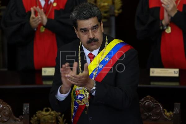 Venezuelan President Nicolas Maduro (C) arrives at the opening ceremony of the judicial year, in Caracas, Venezuela, 24 January 2019.  EFE-EPA/ Cristian Hernandez