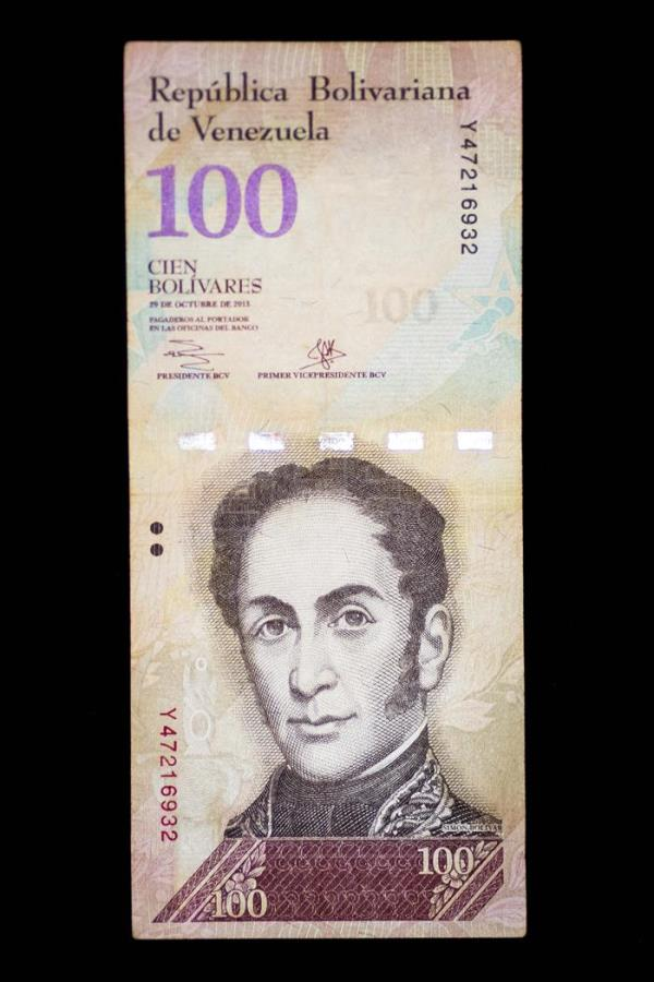 Detail of a current note of 100 Bolivars in Caracas, Venezuela, 22 March 2018. EPA-EFE/Miguel Gutierrez
