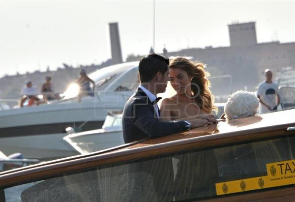 Spanish Alvaro Morata, forward of Real Madrid, and Italian fashion blogger Alice Campello are on board a water taxi after their wedding ceremony in Venice, Italy. EFE/EPA/ANDREA MEROLA
