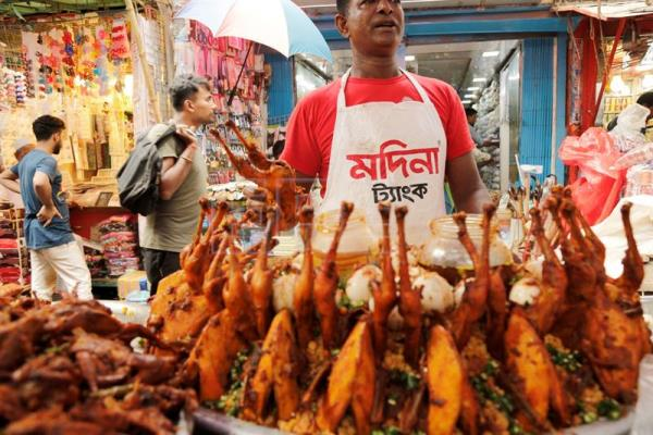 Ramadan is a delectable gastronomic experience in dhaka life a man displays chicken roasts at an open market popular for different kinds of kebab forumfinder Image collections