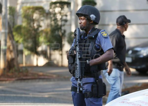 Members of the Hawks special police unit raid the compound of the Gupta family during an early morning raid, Johannesburg, South Africa, Feb. 14, 2018. EPA-EFE/KIM LUDBROOK