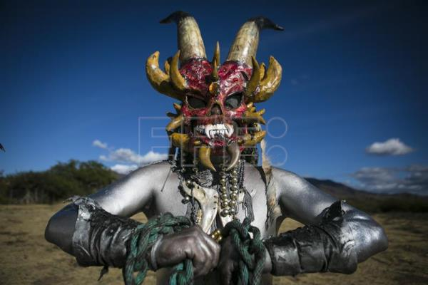 People in costumes participate during the last day of the traditional carnival of San Martin Tilcajete, in Oaxaca State, Mexico, Feb. 14, 2018. EPA-EFE/Mario Arturo Martinez