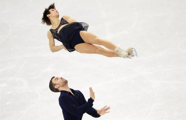 Meagan Duhamel and Eric Radford of Canada perform during the Pair Short Program in the Figure Skating competition at the Gangneung Ice Arena during the PyeongChang 2018 Olympic Games, South Korea, Feb. 14, 2018. EPA-EFE/HOW HWEE YOUNG
