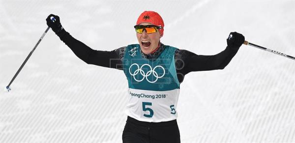 Eric Frenzel of Germany celebrates as he crosses the finish line to win the gold medal during the Cross Country portion of the Nordic Combined Individual Normal Hill / 10 km competition at the Alpensia Ski Jumping Centre during the PyeongChang 2018 Olympic Games, South Korea, Feb. 14, 2018. EPA-EFE/VASSIL DONEV