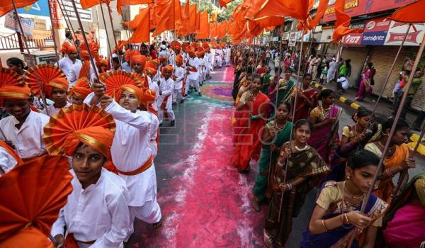 Charming Indian People In Traditional Clothes Participate In The Procession To  Celebrate The Gudi Padwa, Maharashtrianu0027s