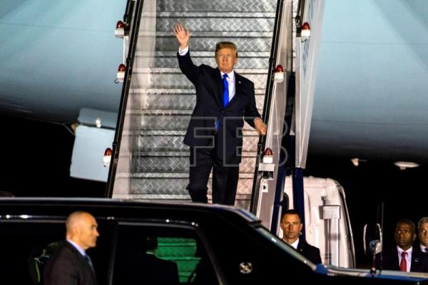 US President Donald J. Trump walks off Air Force One as he arrives at the Paya Lebar Air Base in Singapore, 10 June 2018.