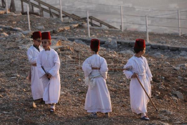 Samaritans take part in sunrise prayers on Mount Gerizim
