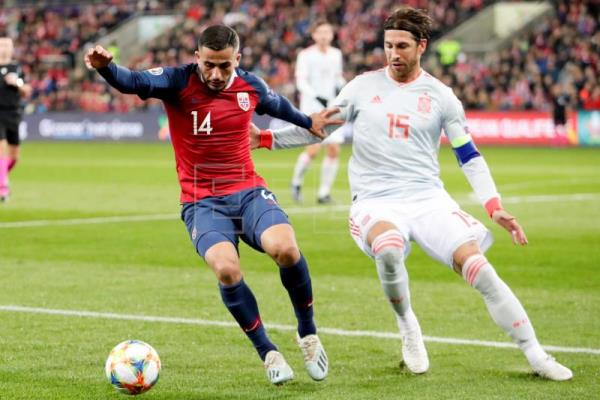 Spain's winning streak ends in 1-1 draw versus Norway; Ramos sets caps record