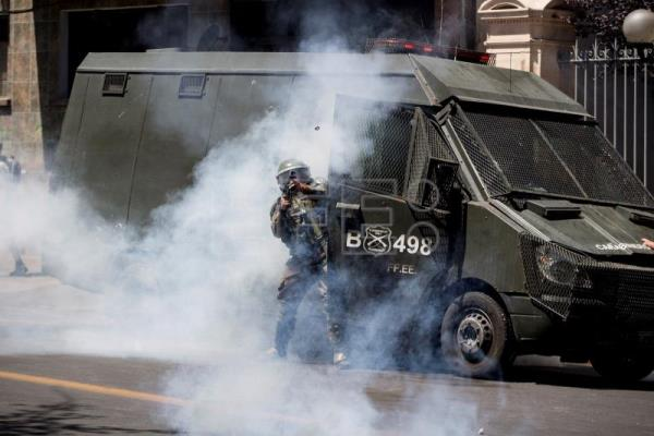 Youth killed by Navy truck, taking Chile protests toll to 12