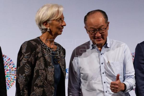 International Monetary Fund (IMF) Managing Director Christine Lagarde (L) and President of the World Bank Group Jim Yong Kim (R) converse during the Trade Conference introduction at the International Monitary Fund (IMF) and World Bank annual meeting in Nusadua, Bali, Indonesia, Oct. 10, 2018. EPA-EFE/MADE NAGI