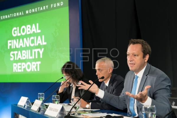 A handout photo made available by the International Monetary Fund (IMF) shows International Monetary Fund Division Chief Anna Ilyina (L), Tobias Adrian (R), IMF Financial Economic Counsellor and Director of the Monetary and Capital Markets Department, Deputy Director Fabio Natalucci (C) presenting the Global Financial Stability Report press briefing at the 2018 IMF/World Bank Annual Meetings at the Bali International Convention Centre in Bali, Indonesia, Oct. 10, 2018. EPA-EFE/IMF/STEPHEN JAFFE HANDOUT