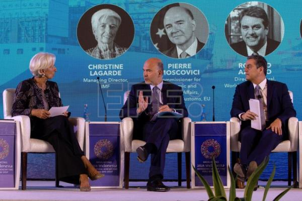 (L-R) International Monetary Fund (IMF) Managing Director Christine Lagarde, European Commissioner for Economic and Financial Affairs Pierre Moscovici and Director General of the World Trade Organization (WTO), Roberto Azevedo take part in a seminar at the IMF and World Bank annual meeting in Nusadua, Bali, Indonesia, Oct. 10, 2018. EPA-EFE/MADE NAGI