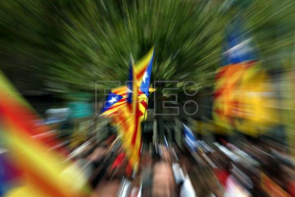 Catalonian flags are seen as thousands attend the gathering to support Catalonia's independence on occasion of the Diada Day (Catalonia's National Day) in Barcelona, Spain, Sept. 11, 2015. EPA-EFE FILE/TONI ALBIR
