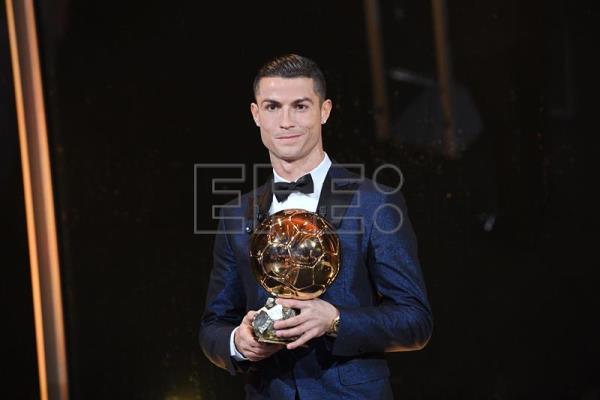 Photo made available by the l'Equipe Presse Office shows Real Madrid's Portuguese striker Cristiano Ronaldo posing with his trophy after receiving the 62nd Ballon d'Or award in Paris, France, Dec. 7, 2017. EPA-EFE/L'EQUIPE/FAUGERE FRANCK