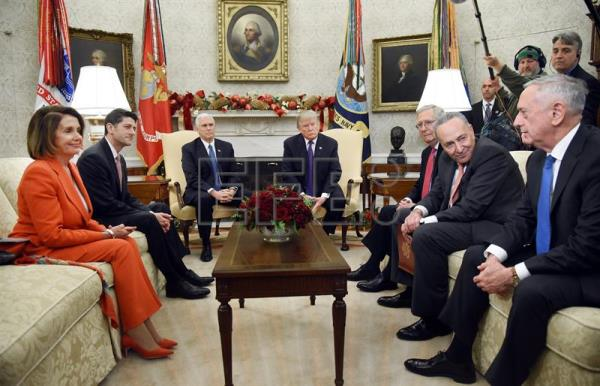 US President Donald J. Trump (4-R) and Vice President Mike Pence (3-L) meet with Congressional leadership including Minority Leader of the United States House of Representatives Nancy Pelosi (L) , House Speaker Paul Ryan (2-L), Senate Majority Leader Mitch McConnell (3-R) and Senator Charles Schumer (2-R) and Defense Secretary Jim Mattis (R) in the Oval Office of the White House in Washington, DC, USA, Dec. 7, 2017. EPA-EFE/OLIVIER DOULIERY / POOL