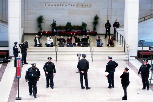 Protesters in favor of the Deferred Action for Childhood Arrivals (DACA) program protest in the US Capitol Visitors Center Emancipation Hall before being arrested in Washington DC, USA, Dec. 7, 2017. EPA-EFE/SHAWN THEW