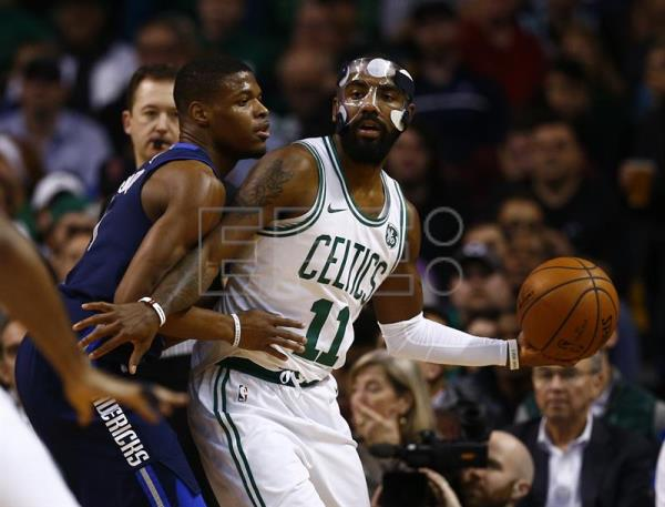 Boston Celtics guard Kyrie Irving keeps the ball from Dallas Mavericks guard Dennis Smith Jr. (L) during the first quarter of their NBA game at TD Garden in Boston, Massachusetts, USA, Dec. 6, 2017. EPA/CJ GUNTHER