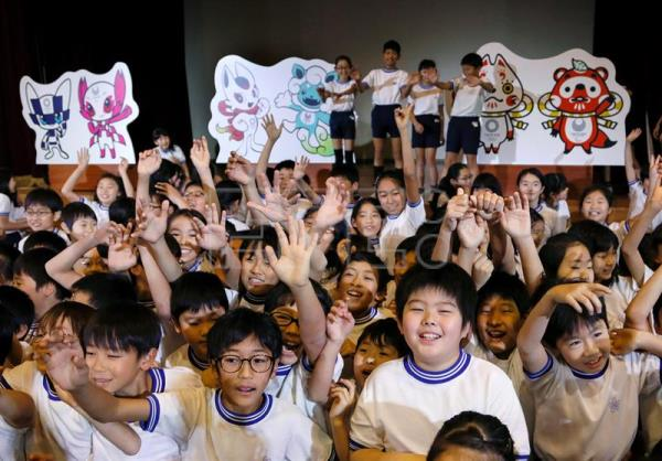 Schoolchildren from fourth and fifth grades celebrate the selection of three shortlisted mascot design sets for the Tokyo 2020 Olympic Games and Paralympic Games at an elementary school in Tokyo, Japan, 07 December 2017. EPA-EFE/KIMIMASA MAYAMA