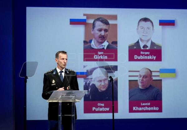 Russia denies MH17 involvement after 4 charged with murder over plane crash