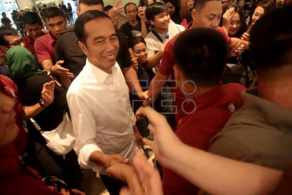 Widodo reelected Indonesian president, rival to challenge poll results