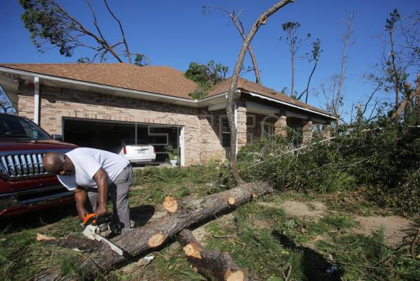 David Jones works to clean his property of fallen trees on Oct. 11, 2018, in Callaway, Florida, after the passage of Hurricane Michael.  EFE-EPA/Dan Anderson
