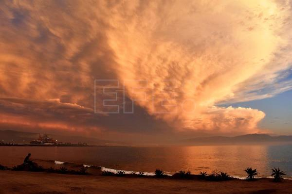 The sunset illuminates clouds near the city of Ensenada in the state of Baja California, Mexico, 01 October 2018. Authorities in Baja California declared a state of emergency on 11 October ahead of tropical storm Sergio. EPA-EFE/FILE/ALEJANDRO ZEPEDA