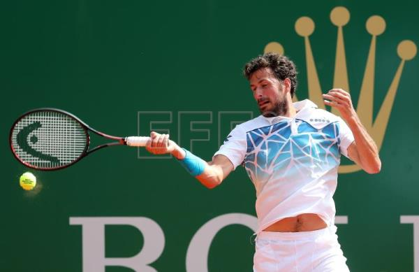 Robin Haase of the Netherlands in action against Andrey Rublev of Russia during their first round match at the Monte-Carlo Rolex Masters tournament in Roquebrune Cap Martin, France, on April 16, 2018. EPA-EFE/SEBASTIEN NOGIER