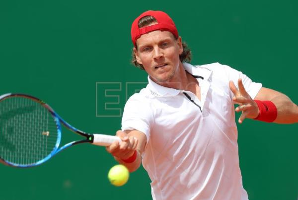 Tomas Berdych of the Czech Republic in action against Kei Nishikori of Japa during their first round match at the Monte-Carlo Rolex Masters tournament in Roquebrune Cap Martin, France, on April 16, 2018. EPA-EFE/SEBASTIEN NOGIER