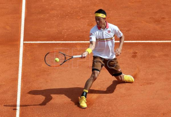 Kei Nishikori of Japan in action against Tomas Berdych of the Czech Republic during their first round match at the Monte-Carlo Rolex Masters tournament in Roquebrune Cap Martin, France, on April 16, 2018. EPA-EFE/SEBASTIEN NOGIER