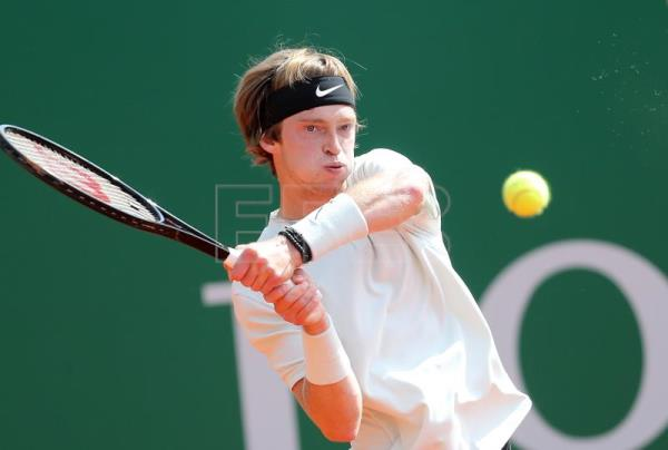 Andrey Rublev of Russia in action against Robin Haase of the Netherlands during their first round match at the Monte-Carlo Rolex Masters tournament in Roquebrune Cap Martin, France, on April 16, 2018. EPA-EFE/SEBASTIEN NOGIER