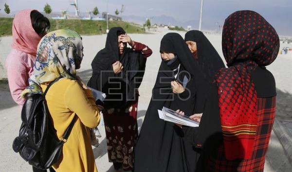 A photo of Gellara staff interacting with women in Kabul after the launch of the first women's magazine in the country. EFE/Jawad Jalali