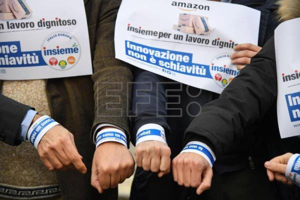 Flash-mob in Piazza Montecitorio of the 'Lista Insieme' to demonstrate against the adoption of electronic wristbands by Amazon that can track workers' movement in Rome, Italy, Feb 2, 2018. EFE-EPA/ALESSANDRO DI MEO