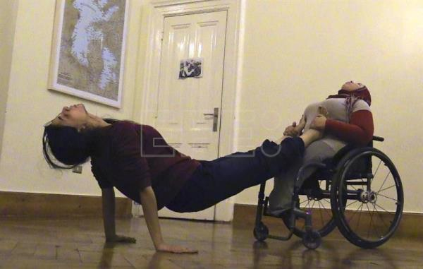 Egyptian Menatalla, who is in a wheelchair, rehearses with the professional dancer Nermin a choreography that will premiere on the streets of Cairo in the framework of Downtown Contemporary Arts Festival in Cairo (D-CAF), Mar. 29, 2017. EFE/Isaac Martín