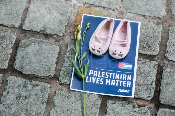 Thousands of empty shoes laid out in Brussels to highlight Palestinian plight