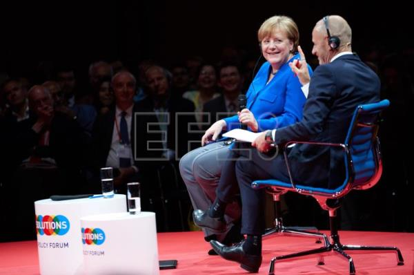 Germany's Merkel urges Italy to respect the eurozone's values